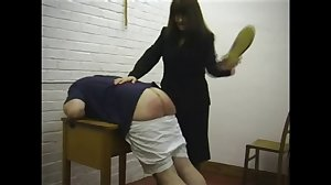 Miss Strict punishes naughty boys.